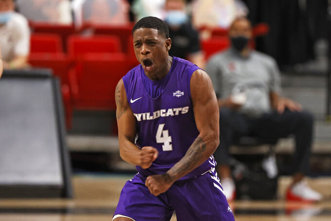 Abilene Christian's Airion Simmons reacts after scoring a 3-point shot during the second half of the team's NCAA college basketball game against Texas Tech, Wednesday, Dec. 9, 2020, in Lubbock, Texas. (AP Photo/Brad Tollefson)