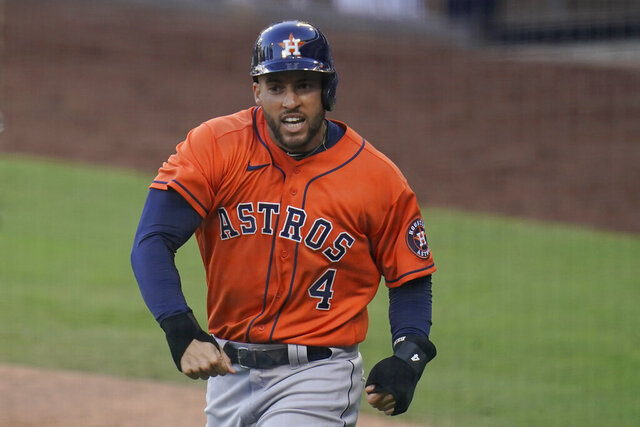 File-This Oct 16, 2020, file photo shows Houston Astros George Springer reacts after scoring on a single by Jose Altuve against the Tampa Bay Rays during the fifth inning in Game 6 of a baseball American League Championship Series in San Diego. Springer, New York Yankees second baseman DJ LeMahieu and Philadelphia catcher J.T. Realmuto were among just six free agents who received $18.9 million qualifying offers on Sunday, Nov. 1, 2020, from their former teams. Three right-handed pitchers also received the offers, Cincinnati's Trevor Bauer, the New York Mets' Marcus Stroman, and San Francisco's Kevin Gausman. (AP Photo/Gregory Bull, File)