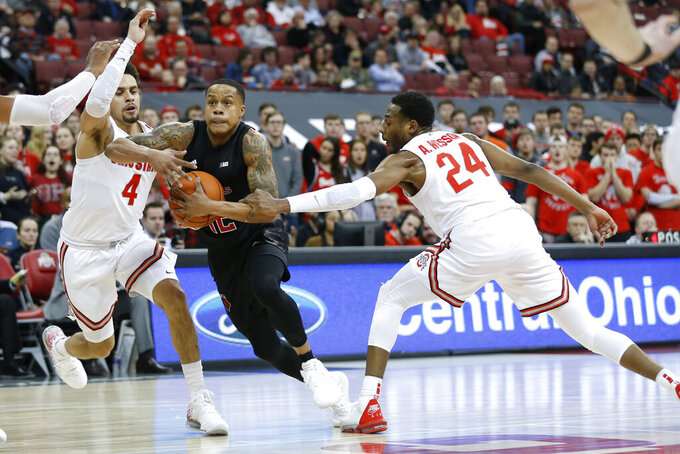 Rutgers Jacob Young, center, drives to the basket between Ohio State's Duane Washington, left, and Andre Wesson during the first half of an NCAA college basketball game Wednesday, Feb. 12, 2020, in Columbus, Ohio. (AP Photo/Jay LaPrete)