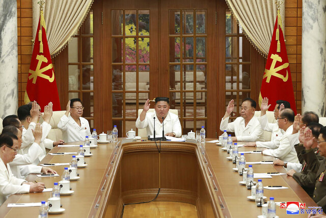 In this photo provided by the North Korean government, North Korean leader Kim Jong Un, center, attends an enlarged meeting of the Politburo of the ruling Workers' Party in Pyongyang, North Korea, Tuesday, Aug. 25, 2020. Independent journalists were not given access to cover the event depicted in this image distributed by the North Korean government. The content of this image is as provided and cannot be independently verified. Korean language watermark on image as provided by source reads: