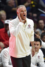 San Diego State coach Brian Dutcher calls to his team during the second half of an NCAA college basketball game against Iowa Friday, Nov. 29, 2019, in Las Vegas. (AP Photo/David Becker)