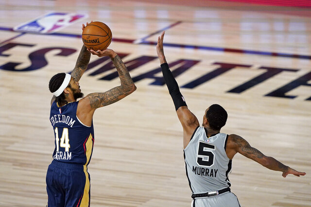 New Orleans Pelicans' Brandon Ingram (14) takes a shot over San Antonio Spurs' Dejounte Murray (5) during the second half of an NBA basketball game, Sunday, Aug. 9, 2020, in Lake Buena Vista, Fla. (AP Photo/Ashley Landis, Pool)
