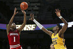 Indiana's Al Durham shoots over Minnesota's Daniel Oturu during the second half of an NCAA college basketball game Wednesday, Feb. 19, 2020, in Minneapolis. Indiana won 68-56. (AP Photo/Stacy Bengs)