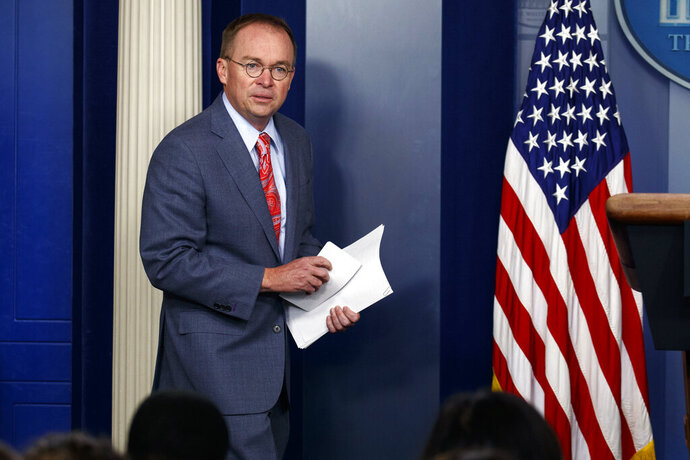 FILE - In this Thursday, Oct. 17, 2019, file photo, White House chief of staff Mick Mulvaney arrives to a news conference, in Washington. On Sunday, Oct. 20, on