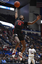 Houston's DeJon Jarreau goes up to dunk during the second half of an NCAA college basketball game against Connecticut, Thursday, Feb. 14, 2019, in Hartford, Conn. (AP Photo/Jessica Hill)
