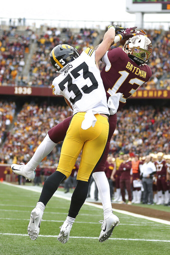 Minnesota wide receiver Rashod Bateman catches the ball in the end zone against Iowa's Riley Moss during an NCAA college football game Saturday, Oct. 6, 2018, in Minneapolis. (AP Photo/Stacy Bengs)