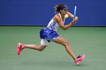Tsvetana Pironkova, of Bulgaria, returns a shot to Alize Cornet, of France, during the fourth round of the US Open tennis championships, Monday, Sept. 7, 2020, in New York. (AP Photo/Seth Wenig)