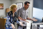 This image released by ABC shows Julie Bowen, left, and Ty Burrell in a scene from the series finale of