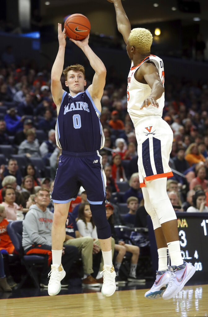Maine forward Andrew Fleming (0) shoots over Virginia forward Mamadi Diakite (25) during an NCAA college basketball game in Charlottesville, Va., Wednesday, Nov. 27, 2019. (AP Photo/Andrew Shurtleff)
