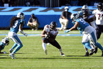 Chicago Bears running back David Montgomery (32) finds some running room against the Carolina Panthers during the second half of an NFL football game in Charlotte, N.C., Sunday, Oct. 18, 2020. (AP Photo/Mike McCarn)