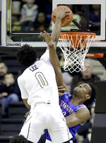 Vanderbilt guard Saben Lee (0) dunks over Tennessee State forward Stokley Chaffee Jr. in the first half of an NCAA college basketball game Saturday, Dec. 29, 2018, in Nashville, Tenn. (AP Photo/Mark Humphrey)