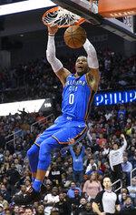 Oklahoma City Thunder guard Russell Westbrook dunks during the second half of an NBA basketball game against the Atlanta Hawks, Tuesday, March 13, 2018, in Atlanta. Oklahoma City won 119-107. (AP Photo/John Amis)
