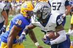 Pittsburgh linebacker Cam Bright (38) pursues New Hampshire running back Carlos Washington Jr. (26) in the first half of an NCAA college football game, Saturday, Sept. 25, 2021, in Pittsburgh. (AP Photo/Keith Srakocic)