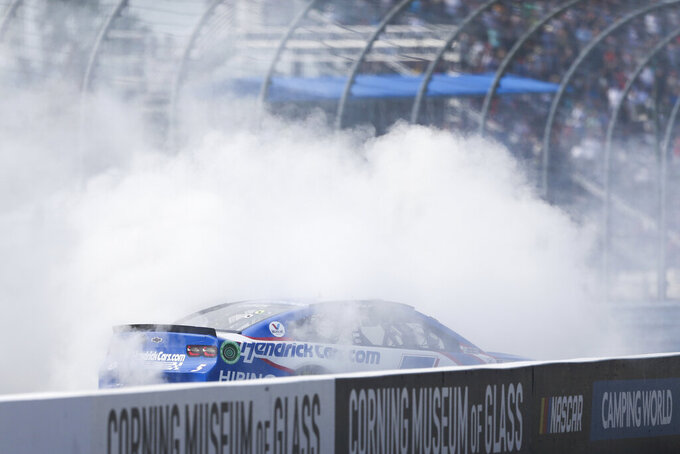 Kyle Larson celebrates with a burnout after winning a NASCAR Cup Series auto race in Watkins Glen, N.Y., on Sunday, Aug. 8, 2021. (AP Photo/Joshua Bessex)