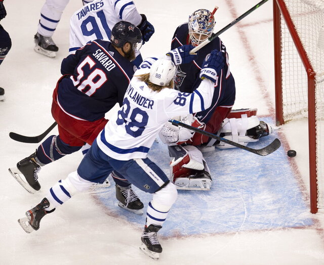 Toronto Maple Leafs right wing William Nylander (88) celebrates the game tying goal as Columbus Blue Jackets goaltender Elvis Merzlikins (90) and Blue Jackets defenceman David Savard (58) react during the third period of an NHL hockey playoff game Friday, Aug. 7, 2020, in Toronto. (Frank Gunn/The Canadian Press via AP)
