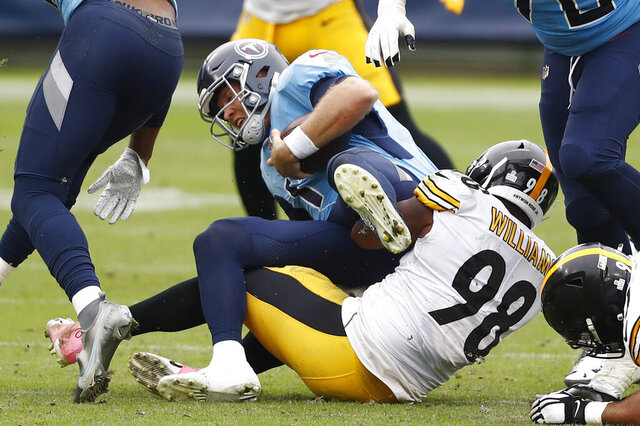 Tennessee Titans quarterback Ryan Tannehill (17) is sacked by Pittsburgh Steelers inside linebacker Vince Williams (98) for a 3-yard loss in the second half of an NFL football game Sunday, Oct. 25, 2020, in Nashville, Tenn. (AP Photo/Wade Payne)