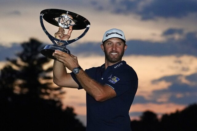 Dustin Johnson holds the trophy after winning the Northern Trust golf tournament at TPC Boston, Sunday, Aug. 23, 2020, in Norton, Mass. (AP Photo/Charles Krupa)