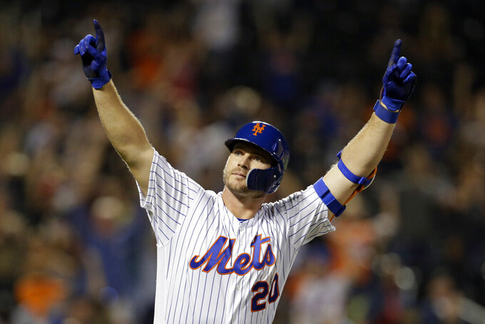 FILE - In this Sept. 28, 2019, file photo, New York Mets' Pete Alonso reacts after hitting hitting his 53rd home run of the season during the third inning of a baseball game against the Atlanta Braves, in New York. Alonso at the plate. Jacob deGrom on the mound. And a healthy Yoenis Céspedes pegged conveniently for designated hitter. There's no question the New York Mets have reasons to believe this pandemic-shortened season is perfect for them -- even without injured starter Noah Syndergaard. All they need to do is pick right up where they left off last year.(AP Photo/Adam Hunger, File)