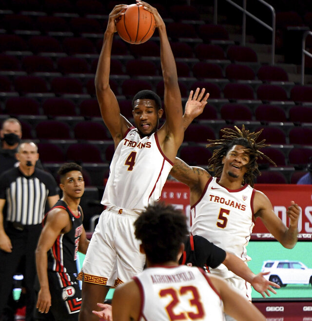 Evan Mobley #4 of the USC Trojans rebounds against the Utah Utes In the first half of a NCAA basketball game at Galen Center on the campus of the University of Southern California in Los Angeles on Saturday, January 2, 2021. (Keith Birmingham/The Orange County Register via AP)