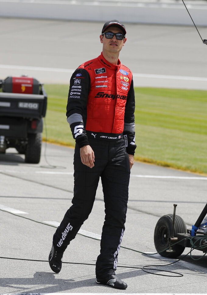 Joey Logano walks to his car before the NASCAR Xfinity Series auto race at Chicagoland Speedway in Joliet, Ill., Saturday, June 29, 2018. (AP Photo/Nam Y. Huh)