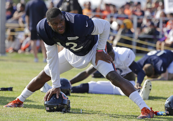 Chicago Bears wide receiver Allen Robinson II stretches on the field during an NFL football training camp in Bourbonnais, Ill., Sunday, July 28, 2019. (AP Photo/Nam Y. Huh)