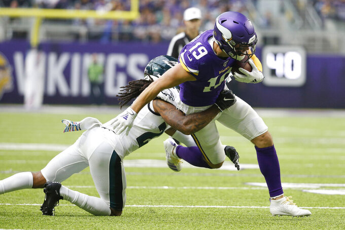 Minnesota Vikings wide receiver Adam Thielen (19) runs from Philadelphia Eagles cornerback Sidney Jones, left, after catching a pass during the first half of an NFL football game, Sunday, Oct. 13, 2019, in Minneapolis. (AP Photo/Bruce Kluckhohn)