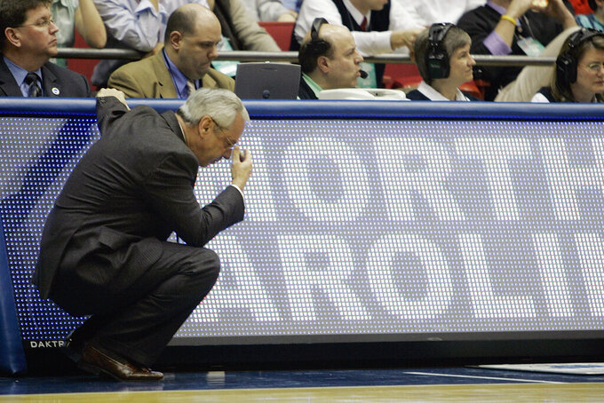 FILE - In this March 19, 2006, file photo, North Carolina head coach Roy Williams looks down near the end of the NCAA second-round men's basketball game against George Mason in Dayton, Ohio. George Mason beat North Carolina, 65-60. (AP Photo/Ed Reinke, File)