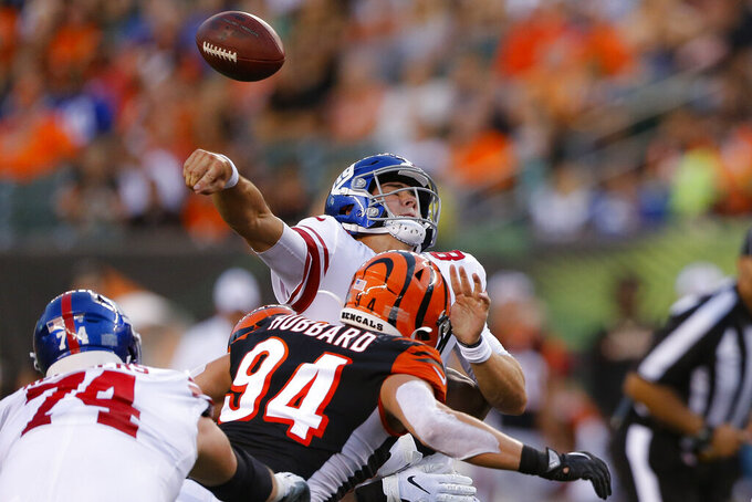 Cincinnati Bengals defensive end Sam Hubbard (94) breaks up a pass by New York Giants quarterback Daniel Jones (8) during the first half of the team's NFL preseason football game Thursday, Aug. 22, 2019, in Cincinnati. (AP Photo/Gary Landers)