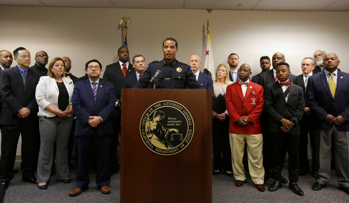 FILE - In this March 27, 2018, file photo, Sacramento Police Chief Daniel Hahn, center, flanked civic and community leaders announced that he has asked Attorney General Xavier Becerra's office to be part of an independent investigation of the shooting death of Stephon Clark by two Sacramento Police officers in Sacramento, Calif. Sacramento police have released over 50 new video and audio clips related to the fatal shooting of the shooting. The Monday, April 16, 2018, video release includes dashboard and body camera footage from responding officers after the March shooting of Stephon Clark. (AP Photo/Rich Pedroncelli, File)