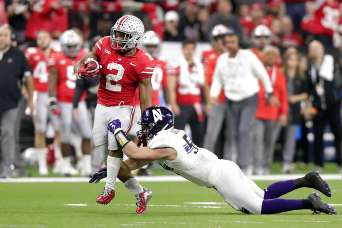 Ohio State running back J.K. Dobbins (2) is tackled by Northwestern linebacker Blake Gallagher during the first half of the Big Ten championship NCAA college football game, Saturday, Dec. 1, 2018, in Indianapolis. (AP Photo/Michael Conroy)