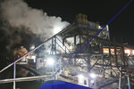 Steam rises from Omega Protein's menhaden processing plant on Cockrell's Creek in Reedville, Va., Tuesday, Nov. 26, 2019. The last east coast fishery now produces fish oil for health supplements and faces a possible moratorium over concerns about overfishing in the Chesapeake Bay. (AP Photo/Steve Helber)