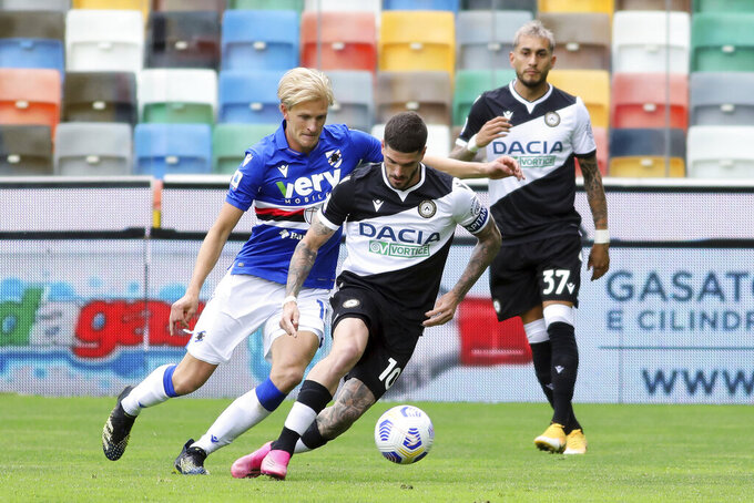 Udinese's Rodrigo De Paul vie for the ball with Sampdoria's Morten Thorsby, left, during the Italian Serie A soccer match between Udinese and Sampdoria, at the Dacia Arena stadium in Udine, Italy, Sunday, May 16, 2021. (Andrea Bressanutti/LaPresse via AP)
