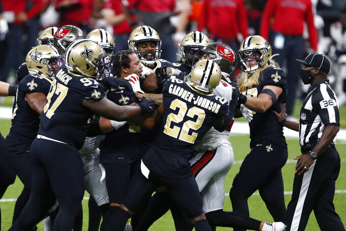 New Orleans Saints and Tampa Bay Buccaneers players scuffle in the first half of an NFL football game in New Orleans, Sunday, Sept. 13, 2020. (AP Photo/Butch Dill)