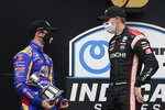 Josef Newgarden, right, talks with Alexander Rossi following an IndyCar auto race at Indianapolis Motor Speedway, Friday, Oct. 2, 2020, in Indianapolis. Newgarden won the race, and Rossi finished second. (AP Photo/Darron Cummings)