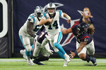 Carolina Panthers quarterback Sam Darnold (14) breaks away from Houston Texans defensive tackle Roy Lopez (91) during the second half of an NFL football game Thursday, Sept. 23, 2021, in Houston. (AP Photo/Eric Christian Smith)
