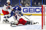 Columbus Blue Jackets goaltender Joonas Korpisalo (70), of Finland, makes a save against Tampa Bay Lightning's Alex Barre-Boulet (60) as Gavin Bayreuther defends during the second period of an NHL hockey game Sunday, April 25, 2021, in Tampa, Fla. (AP Photo/Mike Carlson)