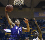 TCU guard Desmond Bane (1) drives while being defended by West Virginia forward Wesley Harris (21) during the first half of an NCAA college basketball game Monday, Feb. 12, 2018, in Morgantown, W.Va. (AP Photo/Raymond Thompson)