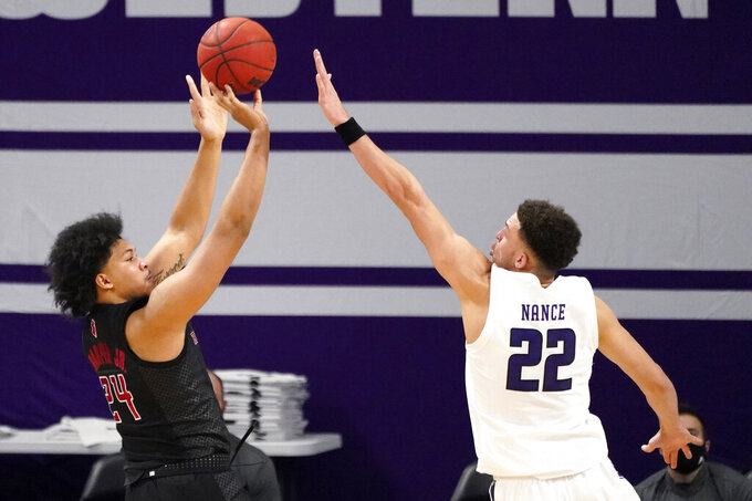 Rutgers guard/forward Ron Harper Jr., left, shoots against Northwestern forward Pete Nance during the second half of an NCAA college basketball game in Evanston, Ill., Sunday, Jan. 31, 2021. (AP Photo/Nam Y. Huh)