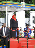Tanzania's new president Samia Suluhu Hassan, center, is sworn in at a ceremony at State House in Dar es Salaam, Tanzania Friday, March 19, 2021. Samia Suluhu Hassan made history Friday when she was sworn in as Tanzania's first female president, following the death of her predecessor John Magufuli. (AP Photo)