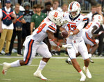 Syracuse quarterback Tommy DeVito (13) hands off to running back Sean Tucker (34) during an NCAA college football game against Ohio, Saturday, Sept. 4, 2021, in Syracuse, N.Y. (N. Scott Trimble/The Post-Standard via AP)