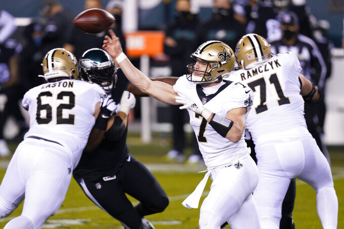 New Orleans Saints' Taysom Hill passes during the first half of an NFL football game against the Philadelphia Eagles, Sunday, Dec. 13, 2020, in Philadelphia. (AP Photo/Chris Szagola)