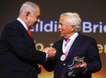 New England Patriots owner Robert Kraft, right, receives Genesis Prize from Israeli Prime Minister Benjamin Netanyahu in Jerusalem, Thursday, June 20, 2019. Israel honored Kraft with the 2019 Genesis Prize for his philanthropy and commitment to combatting anti-Semitism. (AP Photo/Sebastian Scheiner)