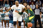 Coastal Carolina center Levi Cook, left, and Baylor forward Freddie Gillespie (33) chase the ball during the second half of an NCAA college basketball game at the Myrtle Beach Invitational in Conway, S.C., Friday, Nov. 22, 2019. (AP Photo/Gerry Broome)