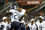 Tennessee Titans running back Dalyn Dawkins (28) celebrates with running back Derrick Henry after Dawkins scored a touchdown during the second half of the team's NFL preseason football game against the Chicago Bears, Thursday, Aug. 29, 2019, in Chicago. Tennessee won 19-15. (AP Photo/David Banks)