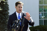 FILE - In this April 3, 2019, file photo, Arizona Gov. Doug Ducey talks to reporters outside the West Wing of the White House in Washington. Ducey is yanking a grant of up to $1 million from Nike amid a report that the athletic company pulled a flag-themed shoe from the market. (AP Photo/Susan Walsh, File)