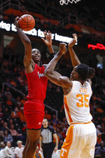 Jacksonville State guard Kayne Henry (11) shoots over Tennessee guard Yves Pons (35) during the second half of an NCAA college basketball game Saturday, Dec. 21, 2019, in Knoxville, Tenn. Tennessee won 75-53. (AP Photo/Wade Payne)