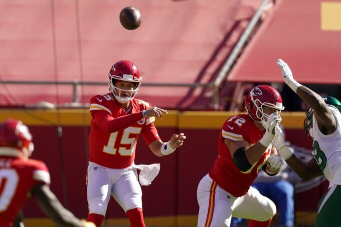 Kansas City Chiefs quarterback Patrick Mahomes (15) throws a pass in the first half of an NFL football game against the New York Jets on Sunday, Nov. 1, 2020, in Kansas City, Mo. (AP Photo/Charlie Riedel)
