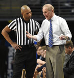 Michigan coach John Beilein tries to plead his case with referee Lewis Garrison during the first half of an NCAA college basketball game against Penn State, Tuesday, Feb. 12, 2019, in State College, Pa. (AP Photo/John Beale)