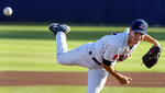 Arizona pitcher Dawson Netz delivers against Mississippi during the top of the first inning of an NCAA college baseball super regional game Sunday, June 13, 2021, in Tucson, Ariz. (Rebecca Sasnett/Arizona Daily Star via AP)
