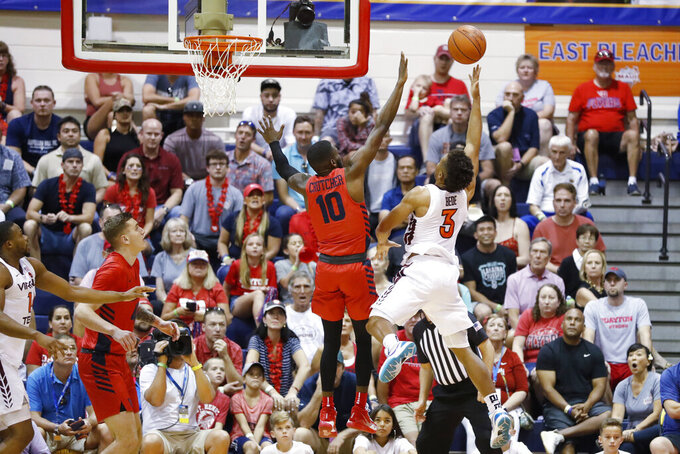 Virginia Tech guard Wabissa Bede (3) attempts to shoot over Dayton guard Jalen Crutcher (10) during the first half of an NCAA college basketball game Tuesday, Nov. 26, 2019, in Lahaina, Hawaii. (AP Photo/Marco Garcia)